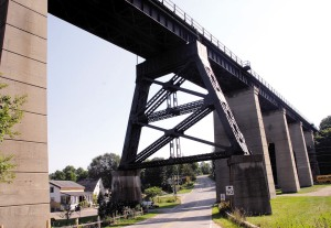 This easterly view of the Michigan Central Railway bridge, which spans Kettle Creek, Fingal Line and Sunset Road, shows the massive concrete piers that support the structure built in 1929.