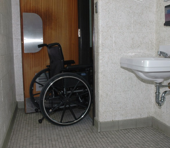 Typical of the washrooms throughout the Colin McGregor Justice Building . . . virtually inaccessible to anyone in a wheelchair.