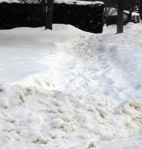 A stretch of sidewalk on Confederation Dr. remains unplowed a week after snow squalls hit St. Thomas.