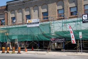 Contractors undertaking renovations to storefronts on Talbot St. at Hiawatha St. are hoping the city can cut them some slack to allow them to park vehicles in front of their work site.