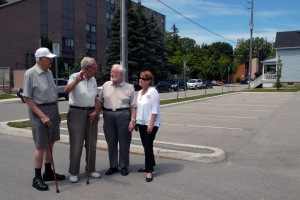 They may not look like street fighters, however Metcalfe Gardens residents Ray Scratch, left, Jim Cumming, Bill Pennings and general manager Lori Lackey - seen here standing in the nearly empty Crocker St. parking lot - have been battling the city for almost a year over restrictive parking measures in the courthouse area. Visitors to the retirement residence often have to park blocks away when coming to see friends and family.