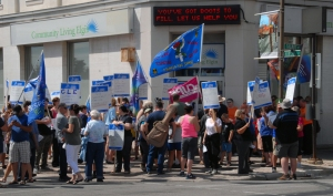 About 100 people gathered outside Community Living Elgin's Talbot St. office Thursday Aug. 20, 2015 at noon to protest the layoffs and service cuts announced by the agency last week.